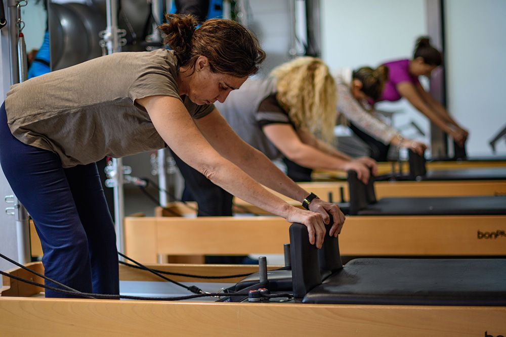 Personas clase pilates reformer