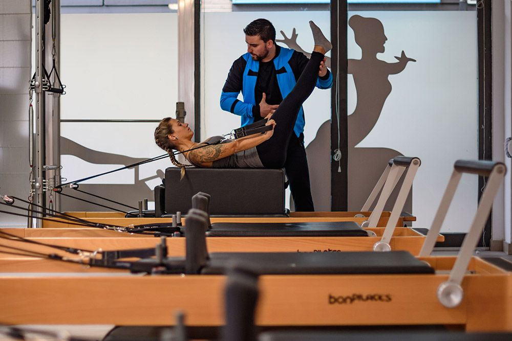 pilates maquinas reformer instructor